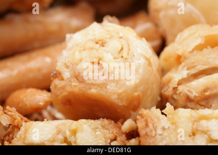 Macro shot of a tasty arabian desert Baklava. Is a rich, sweet pastry made of layers of phyllo pastry filled with - Stock Photo