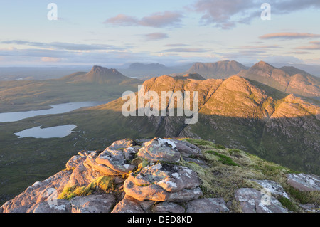 Late evening sunlight on Stac Pollaidh, Beinn an Eoin, Cul Mor, Cul Beag, Suilven and the mountains of Inverpolly, - Stock Photo