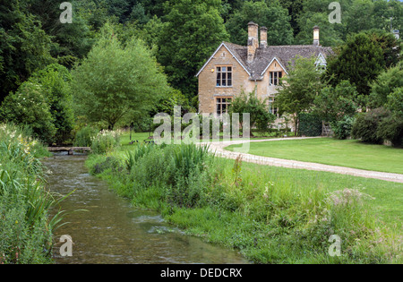 View along the River Eye in Upper Slaughter in the Cotswolds - Stock Photo