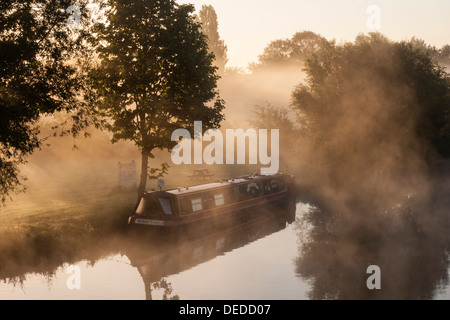 Narrowboat on the River Thames in the Mist - Stock Photo