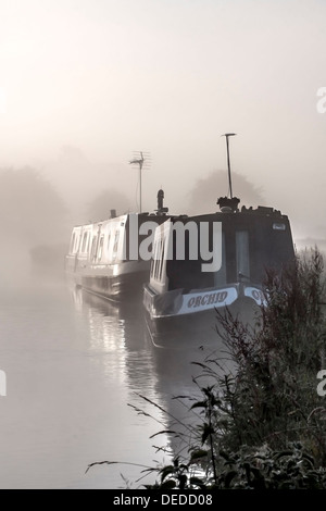 Narrowboat in mist - Stock Photo