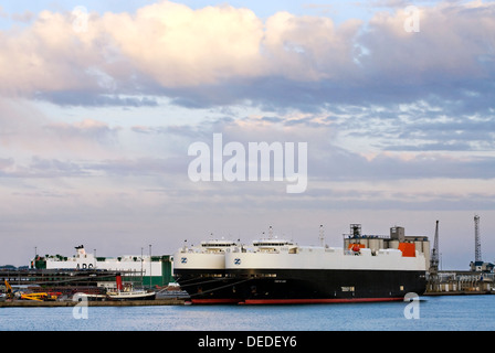 Car Transporter Ship at Southampton Harbour at Sunset , Hampshire, South England. - Stock Photo