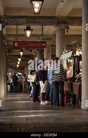 Shoppers inside Covent Garden Market, London - Stock Photo