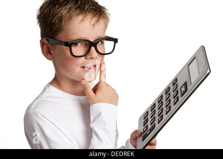 Clever looking boy with caculator. Shot in studio on white background. - Stock Photo