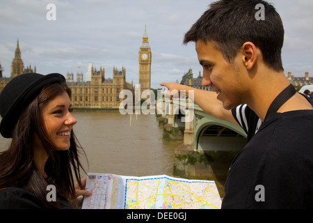 Big Ben and young couple looking at map, London, England, United Kingdom, Europe - Stock Photo