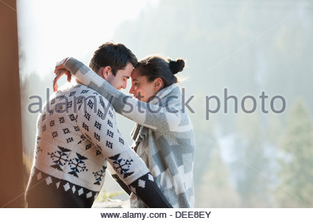 Couple hugging face to face outdoors - Stock Photo