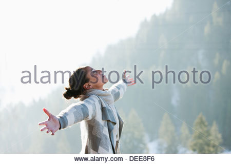 Woman with head back and arms outstretched - Stock Photo