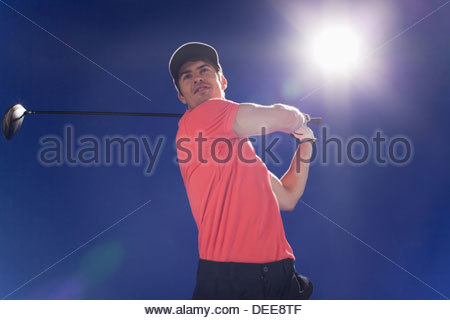 Golf player swinging club - Stock Photo