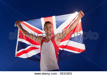 Athlete carrying Union Jack flag - Stock Photo