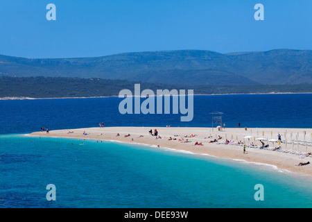 Beach, Zlatni Rat (Golden Horn) and the island of Hvar in the background, Bol, Brac Island, Dalmatia, Croatia, Europe - Stock Photo