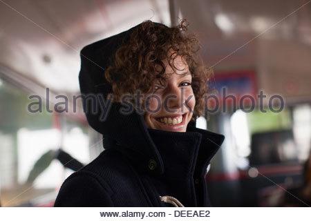 Smiling woman riding bus - Stock Photo