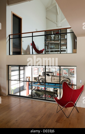 Double height area with vintage cars the home of Bruno and Dominique Lafourcade in Provence