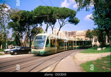 Tram close to the Colosseum in Rome. Italy - Stock Photo