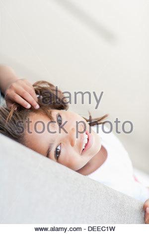 African girl laying on sofa - Stock Photo