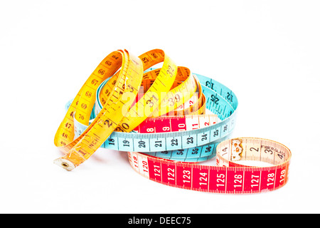 Three colorful intertwined tape measures - Stock Photo