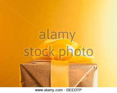 Christmas gift with gold ribbon - Stock Photo