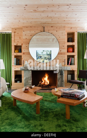 Stone Fireplace In Panelled Living Room With Beamed Ceiling Stock ...