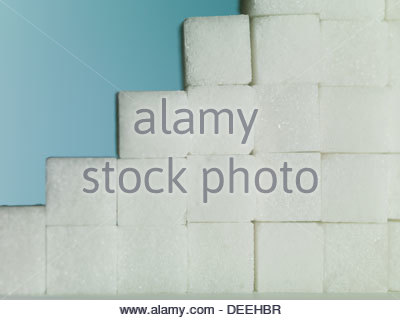close up of Sugar cubes forming steps - Stock Photo