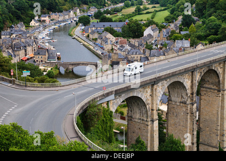 A motorhome crosses the viaduct above the Old Port and River Rance at Dinan, Côtes-d'Armor, Brittany, France - Stock Photo