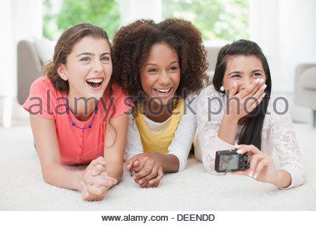 Teenage girls taking self-portrait - Stock Photo