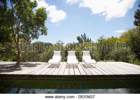 Swimming pool and lounge chairs - Stock Photo