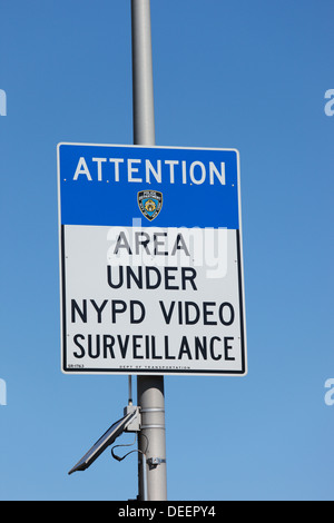 Area under surveillance sign in New York City, USA. - Stock Photo