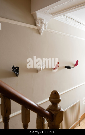 Wall mounted sculptural hands provide unusual coat hooks - Stock Photo