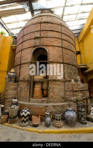 Old kiln oven at the Uriarte Talavera factory in Puebla, Mexico - Stock Photo