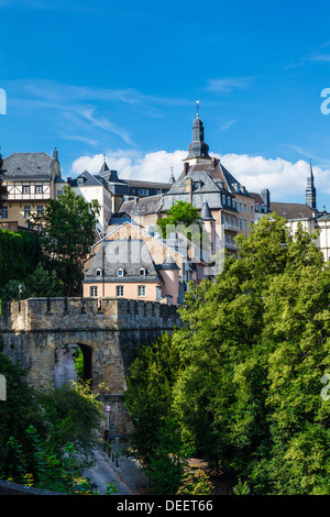 View towards the medieval Ville Haute from the Ville Basse or Grund district of Luxembourg City. - Stock Photo
