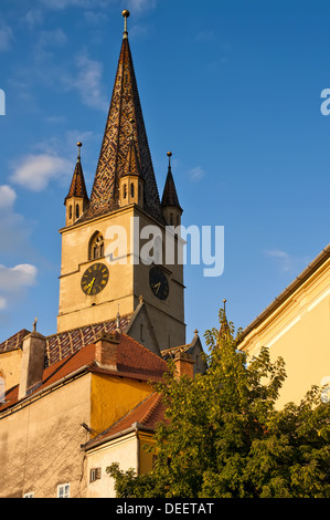church from historic center in sibiu (Hermannstadt) at sunset - Stock Photo