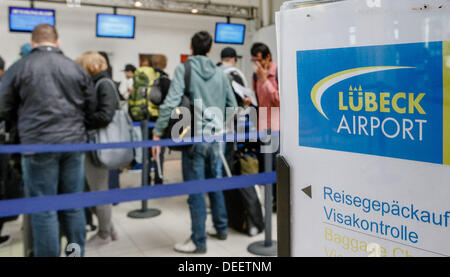 Passengers of a Ryanair flight queue at a check-in desk at the airport Blankensee in Luebeck, Germany, 17 September - Stock Photo