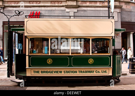 Bridgeview Station Tramway Co. Ltd Tram car outside the H&M retail store is a small cafe catering for the people - Stock Photo