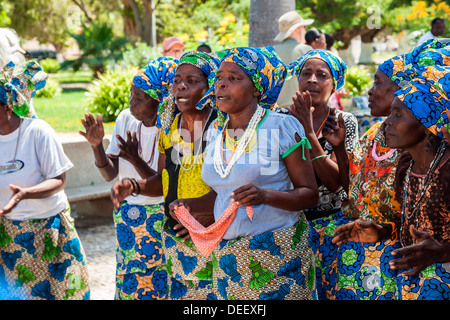 Africa, Angola, Benguela. Woman dancing in town square. - Stock Photo