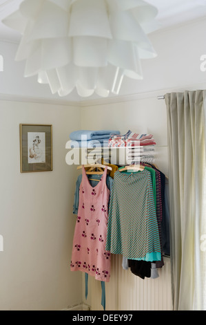 Clothes storage shelves and hanging area - Stock Photo