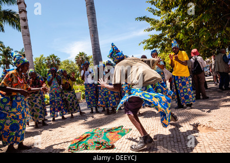 Africa, Angola, Benguela. Women and men dancing in traditional dress. - Stock Photo