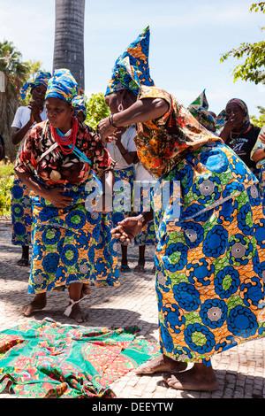 Africa, Angola, Benguela. Women dancing in traditional dress. - Stock Photo
