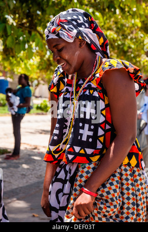 Africa, Angola, Benguela. Woman dancing in traditional dress. - Stock Photo