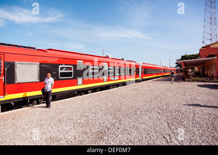 Africa, Angola, Lobito. Man standing beside train. - Stock Photo