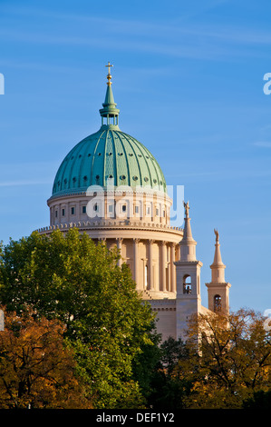 Nikolaikirche (church) in Potsdam, Brandenburg, Germany at sunset. - Stock Photo