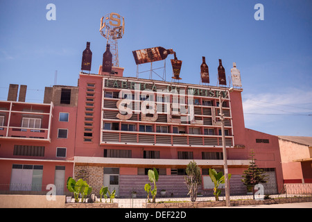 Africa, Angola, Lobito. Roadside shot of Sbell Whiskey factory. - Stock Photo