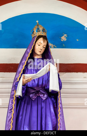 Africa, Angola, Luanda. Close-up shot of idol in Church of Our Lady of the Remedies. - Stock Photo