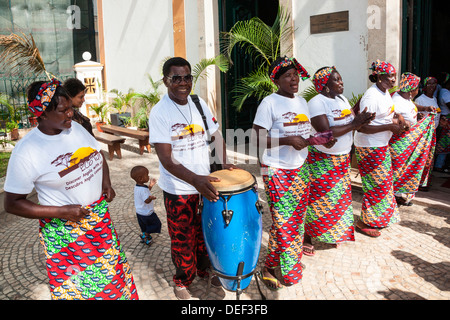 Africa, Angola, Luanda. Musicians drumming and singing outside of the Church of Our Lady of Remedies. - Stock Photo