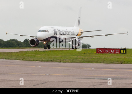 Monarch Airlines plane taxiing at Luton Airport - Stock Photo