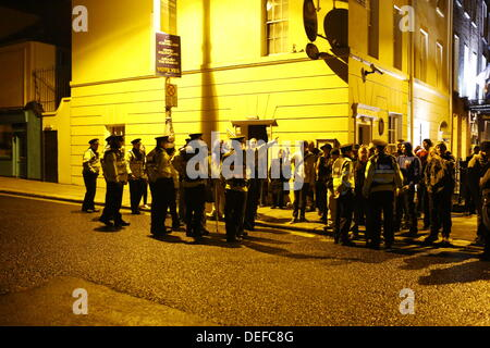 Dublin, Ireland. 18th September 2013. Garda officers (Irish Police) move protesters from outside the Dail (Irish - Stock Photo