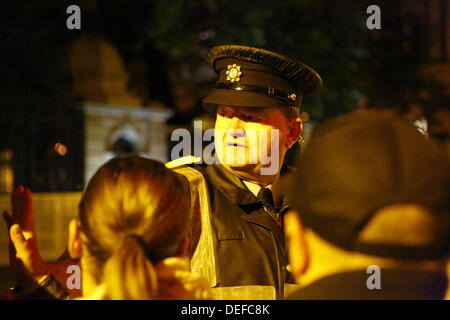 Dublin, Ireland. 18th September 2013. A Garda inspector (Irish Police) looks over the protesters. Protesters gathered - Stock Photo