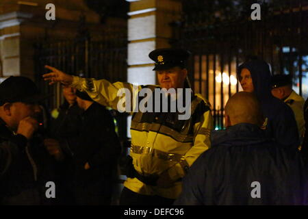 Dublin, Ireland. 18th September 2013. A Garda inspector (Irish Police) tells the protesters that they have to move - Stock Photo