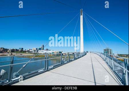 Bob Kerrey Pedestrian Bridge crossing the Missouri River from Nebraska to Iowa, Omaha, Nebraska, United States of - Stock Photo