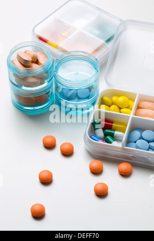 Schedule box containing capsules and capsules - Stock Photo