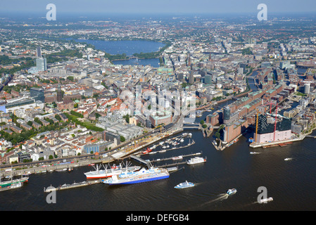 View from the Elbe River over the Alster lakes, the harbour and the Speicherstadt historic warehouse district, aerial - Stock Photo