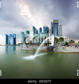 The Merlion Statue with the city skyline in the background, Marina Bay, Singapore, Southeast Asia, Asia - Stock Photo